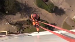 One of the abseilers who cleans cladding on Hull City Council's 26 tower blocks.